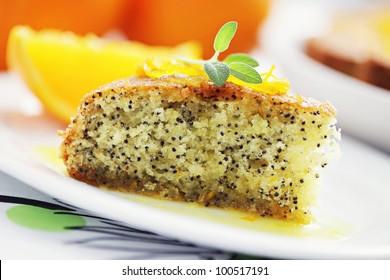 homemade orange cake with poppy seeds - sweet food /shallow DOFF/