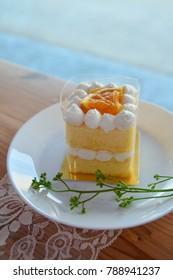 Homemade Orange cream cake with orang topping