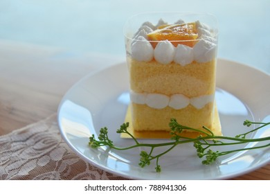 Homemade Orange fresh cream Cake with Orange topping and fresh cream