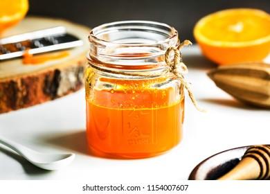 Homemade Orange Syrup in Mason jar by ingredients