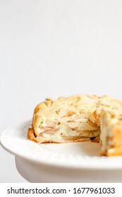 Homemade Organic Apple Pie Dessert Charlotte. Cobbler Apple Pie on White Plate and white background