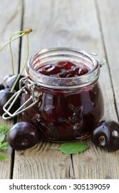 homemade organic cherry jam on a wooden table