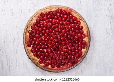 Homemade organic cherry pie dessert ready to eat, close up. Cherry tart. Top view