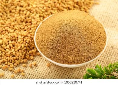 Homemade organic fenugreek seeds powder ,ingredient in Indian cuisine.
