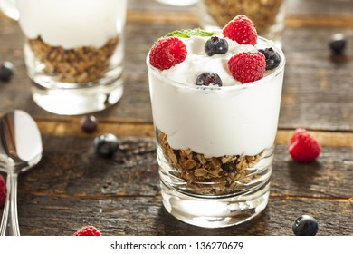 Homemade Organic Fresh Fruit Parfait with berries and granola