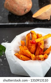 Homemade oven baked sweet and juicy,  sweet potato fries. Ketchup and sea salt.