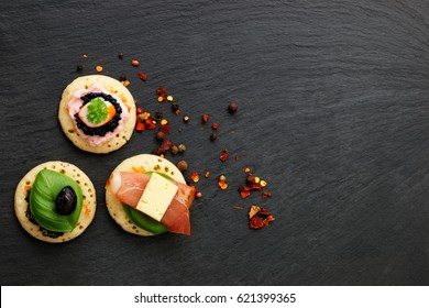 Homemade pancake canapes on slate stone plate for finger food party