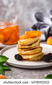 Homemade pancakes with apricot jam and berry