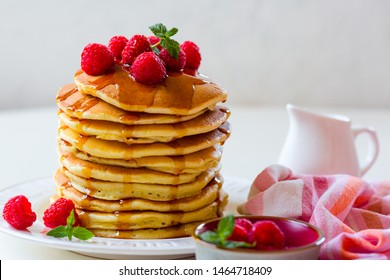 Homemade pancakes with maple syrup and  raspberries
