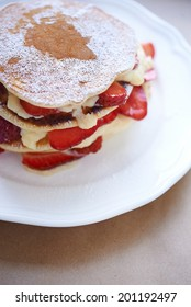 homemade pancakes with strawberry and cream