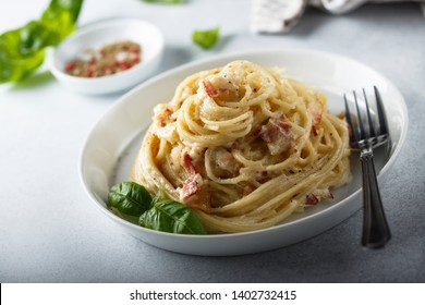 Homemade pasta with fried bacon