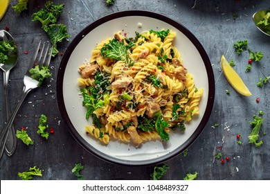 Homemade Pasta fusilli with Chicken, Green Kale, Garlic, lemon and parmesan cheese. healthy home food