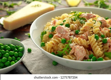 Homemade Pasta fusilli with salmon, green peas, parmesan cheese and lemon. healthy food