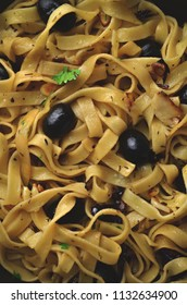 Homemade pasta with herbs and olives
