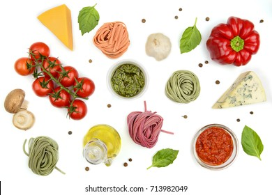Homemade pasta, oil, sauce and vegetables, cooking background, top view