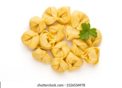 Homemade pasta,  raw tortellini with herbs.