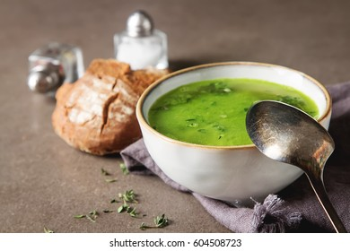 Homemade pea soup with bread. Dark background