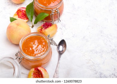 Homemade peach jam with organic fruit. Sweet preserves on a light background, , copy space