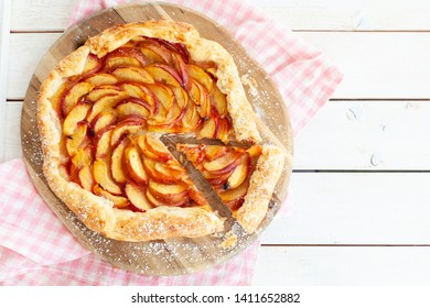 Homemade peach pie made with flakey puff pastry