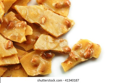 Homemade peanut brittle on a white background