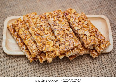 Homemade peanut sesame snack, (Tua gra joak) sweet peanuts stick.
