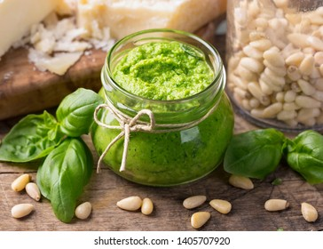Homemade pesto with pine nuts on a blue wooden background