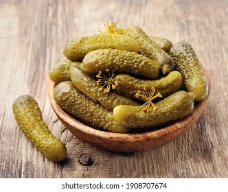 Homemade pickled cucumbers on white backgrounds.