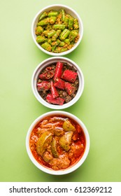 Homemade Pickles of Red/Green Chilli and Mango, also known as Mirchi and Aam ka achar Served in bowls, selective focus