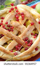 Homemade  pie  with apple and red cherry