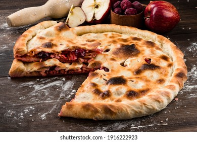 Homemade pie on wooden background, American sweets concept tasty homemade apple and cherry pie on old rustic wooden table, copy space