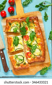 Homemade pie of puff pastry with vegetables.
