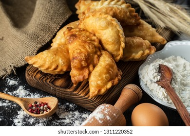 Homemade pies with cabbage on a wooden rustic  table. Advertising still life from baking