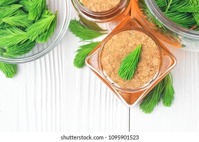 Homemade pine cough syrup for dry irritating throat coughs. Made from green young pine buds and honey.Alternative medicine concept on white wooden table,top view (selective focus).