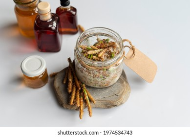 Homemade pine cough syrup.  Made from green young pine buds and honey. Alternative medicine concept on white wooden table,   top view (selective focus).