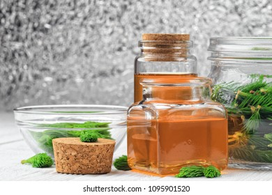 Homemade pine syrup for dry irritating throat coughs. Made from green young pine buds and honey.Alternative medicine concept on white wooden table (selective focus).