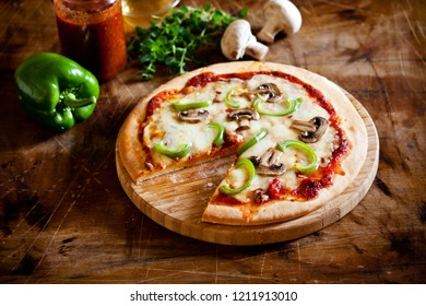 Homemade pizza with fresh organic mushrooms and pepper
