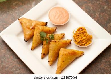 Homemade samoosa's Plated and served