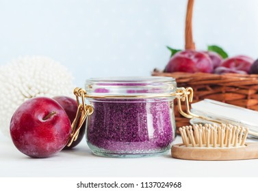 Homemade plum face and body scrub/foot soak/bath salt in a glass jar. DIY cosmetics and spa. Copy space.