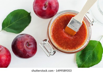 Homemade plum face mask in a glass jar. DIY cosmetics and spa recipe. Top view, copy space.
