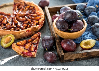 Homemade plum pie, autumn dessert with fresh plums, baking, healthy vegetarian food