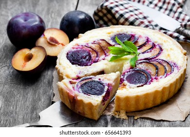 Homemade  plum pie on wooden table