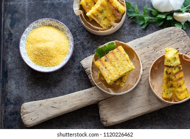 Homemade Polenta on a trencher and dark background