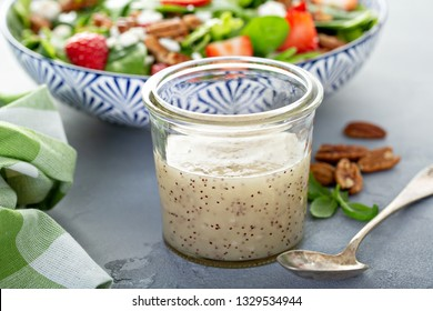 Homemade poppy seed salad dressing in a glass jar