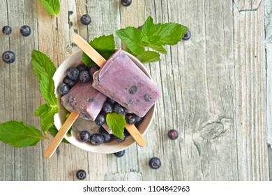 homemade popsicles made out of blueberry and milk