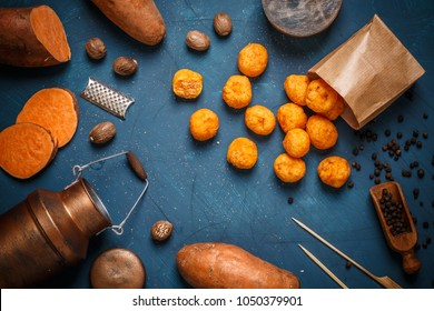 Homemade potato croquettes on blue background