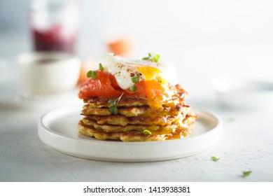 Homemade potato pancakes with smoked salmon and poached egg