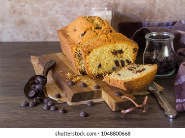 Homemade pound cake with chocolate drops on a wooden cutting board. Homemade pastry for breakfast or dessert.