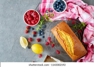 Homemade pound cake or lemon cake with berries filling also known as gateaux de voyage cake, french cuisine, view from above, copy space