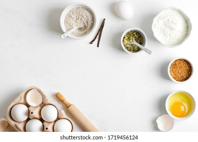 Homemade production of fresh healthy bread of other pastry from natural ingredients on a light grey background.