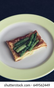 homemade puff pastry sandwich with gammon and green asparagus